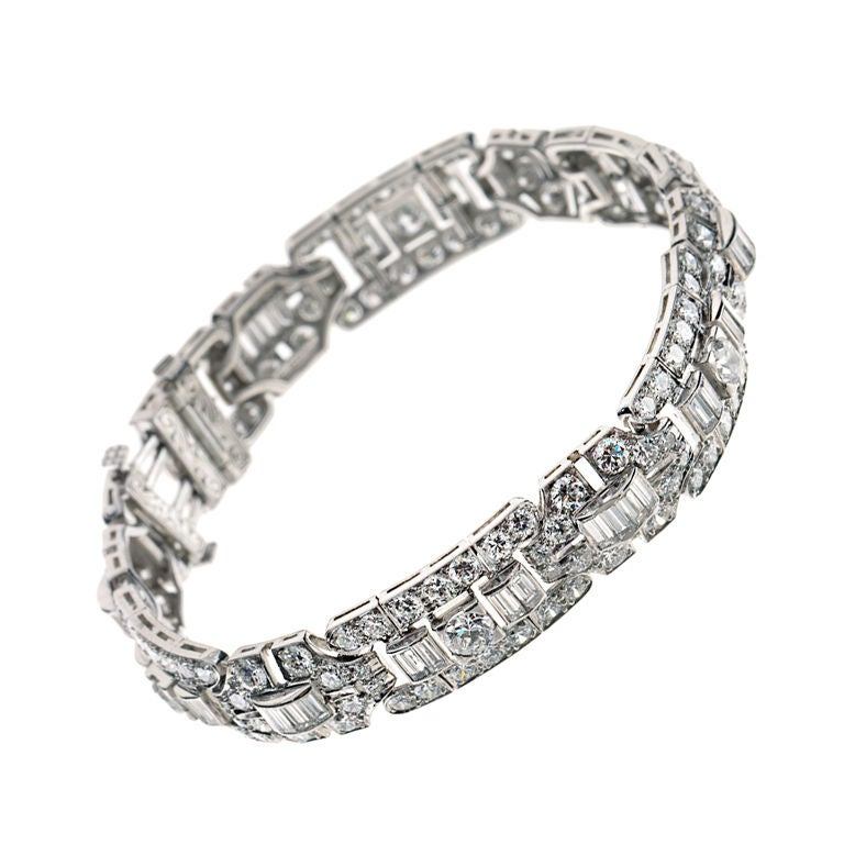 This Art Deco diamond bracelet by Tiffany & Co. is composed of platinum with old European cut round diamonds and baguette diamonds