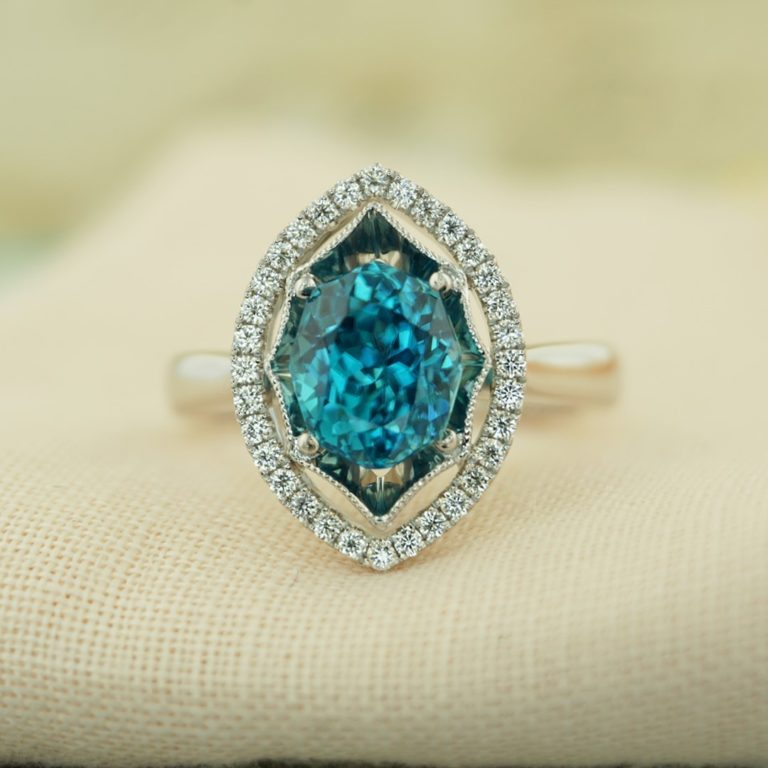 Blue Zircon is doubly refractive which means that it sparkles…